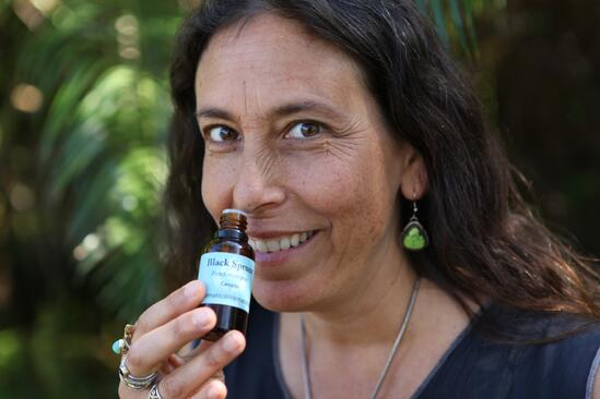 Andrea smelling oil