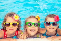 bigstock-Happy-Children-In-The-Swimming-180603583.jpg